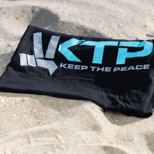 Keep the Peace Original Shirt Beach Folded