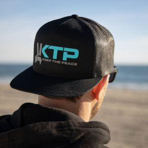 Keep the Peace Original Trucker Hat Mens Backwards