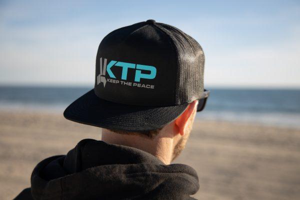 Keep the Peace Original Trucker Hat Mens Backwards
